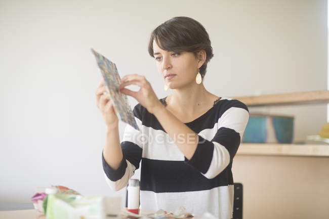 Woman making craft from carton — Stock Photo