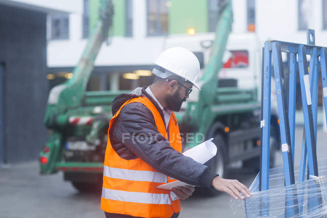 Male civil engineer checking equipment — Stock Photo
