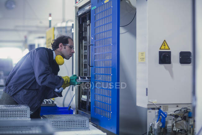 Male engineer working at industrial plant — Stock Photo