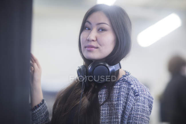Woman with headphones looking in camera — Stock Photo