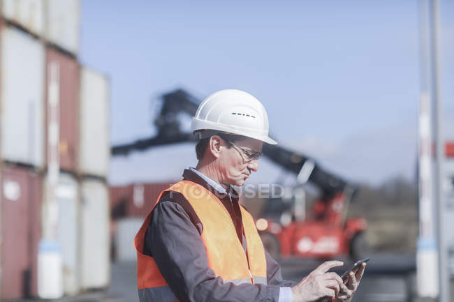 Industrial worker using digital tablet on construction site — Stock Photo