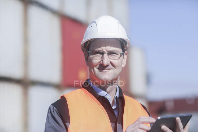 Portrait of mature industrial worker with digital tablet — Stock Photo