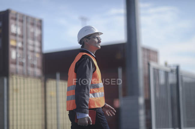 Construction worker walking at workplace with digital tablet — Stock Photo