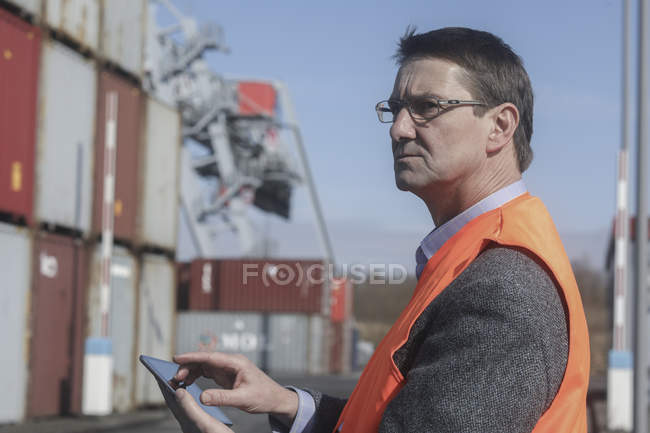 Mature engineer using digital tablet at construction site — Stock Photo