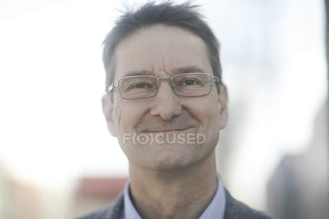Portrait of mature businessman in spectacles — Stock Photo