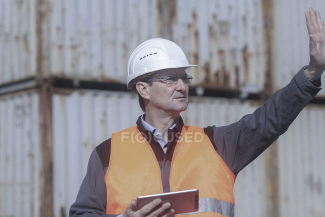 Worker with digital tablet making stop gesture on construction site — Stock Photo