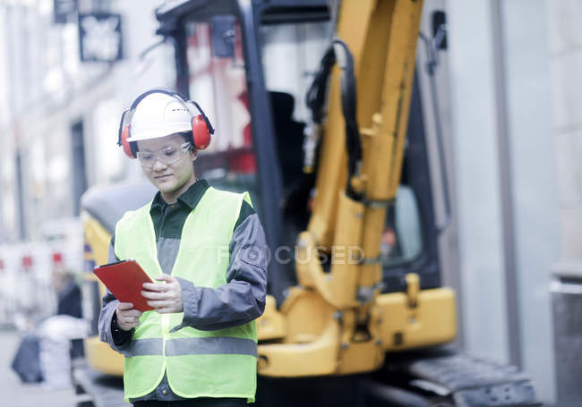 Male civil engineer using digital tablet on construction site — Stock Photo