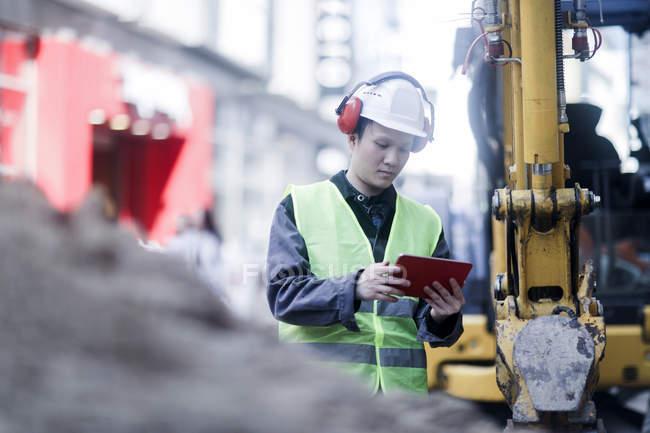 Civil engineer using digital tablet on construction site — Stock Photo
