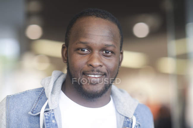 Portrait of cheerful African American man looking in camera — Stock Photo