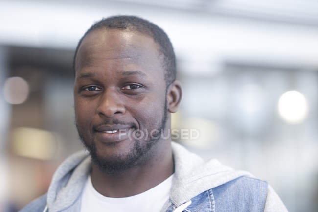 Portrait of African American man looking in camera and smiling — Stock Photo
