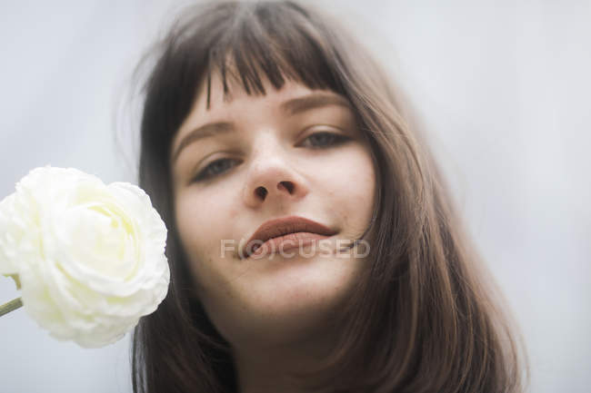 Portrait Of Young Woman With White Rose One Person
