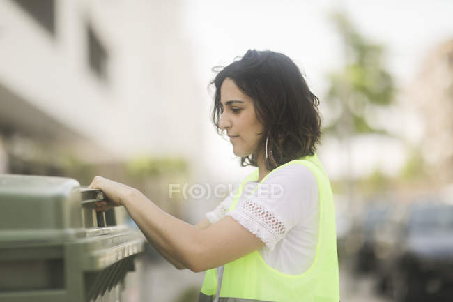 Side view of female building surveyor examining industrial equipment — Stock Photo