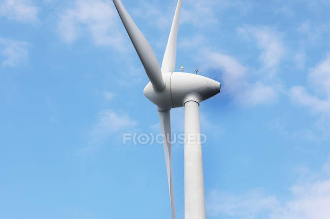 White turbine of windmill against blue sky. — Stock Photo