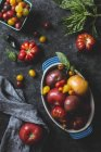 Various sizes and colours of Tomatoes — Stock Photo