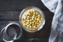 Chickpeas soaking in jar — Stock Photo