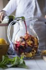 Woman preparing Sangria at home — Stock Photo