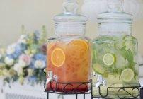 Orange and lime fresh juice — Stock Photo