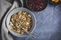 Quinoa Crunch and pomegranate seeds — Stock Photo