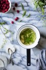 Verbena leaves in pan with water — Stock Photo