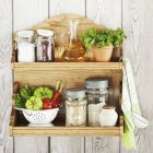 Kitchenware and products on shelf — Stock Photo
