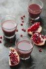 Ripe pomegranates with juice — Stock Photo