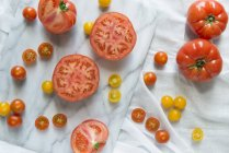 Red and yellow tomatoes — Stock Photo