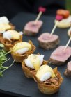 Appetizers with meat and hollandaise sauce — Stock Photo