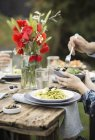 People having lunch in garden — Stock Photo