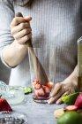 Woman cooking Strawberry Margarita — Stock Photo