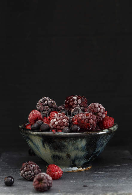 Frozen berries in bowl — Stock Photo