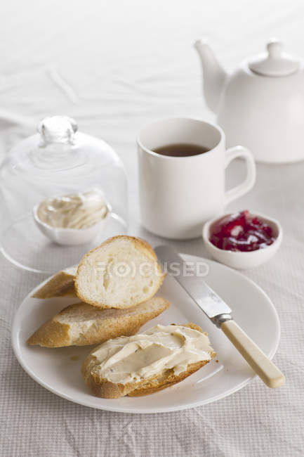 Breakfast with cup of tea and Jam with bread — Stock Photo