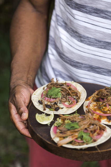 Man holding beef chili tacos — Stock Photo