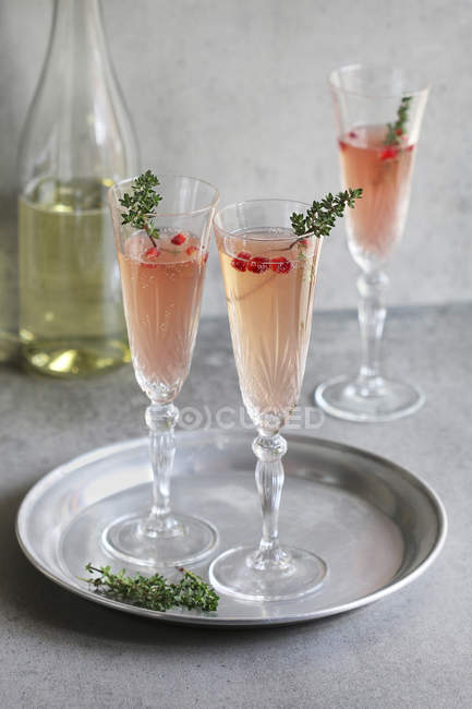 Pomegranate champagne in glasses — Stock Photo