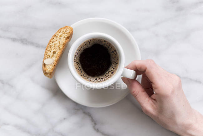 Black coffee on marble worktop — Stock Photo