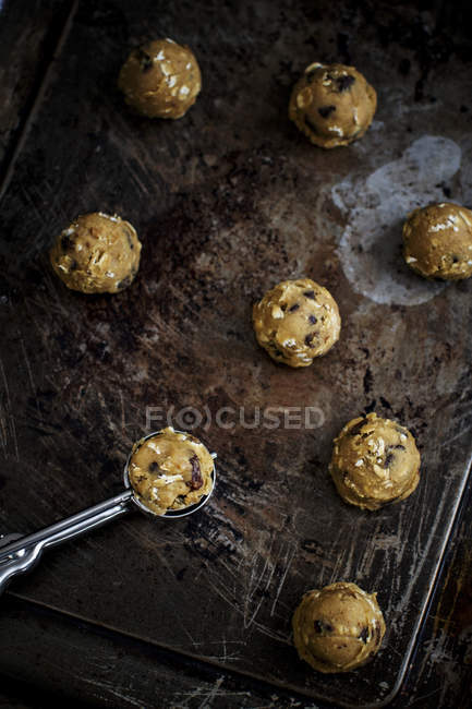 Uncooked oat cookies with raisins — Stock Photo