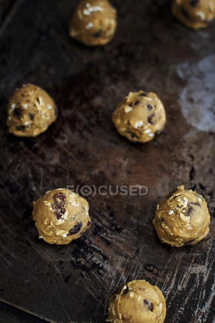 Uncooked oat cookies with raisins — Stock Photo