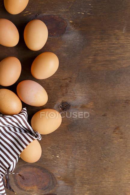 Fresh eggs on brown — Stock Photo