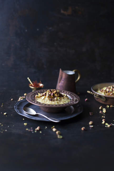 Saffron and pistachios rice pudding — Stock Photo