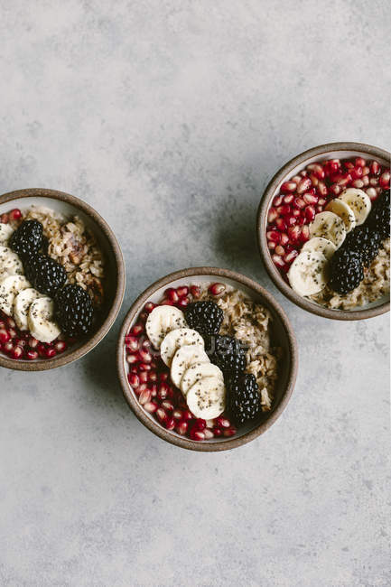 Oatmeal with Banana and Pomegranate Seeds — Stock Photo