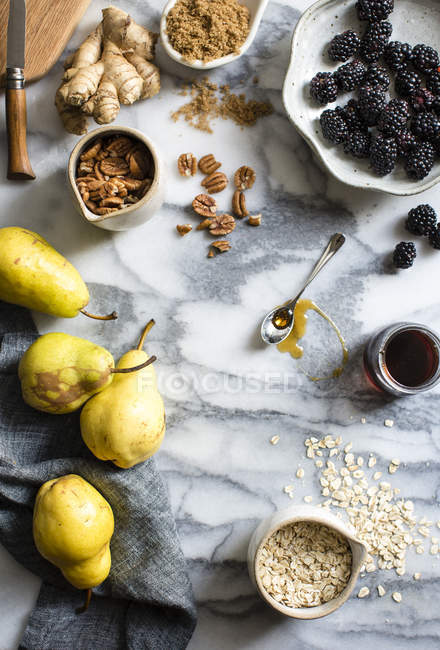 Ingredients on marble surface — Stock Photo