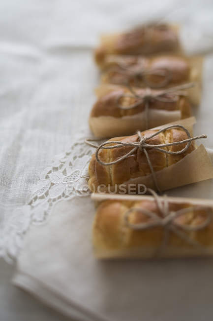 Brioche buns wrapped with parchment — Stock Photo