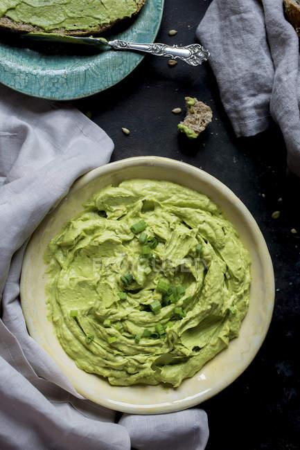 Creamy Avacado dip in plate — Stock Photo