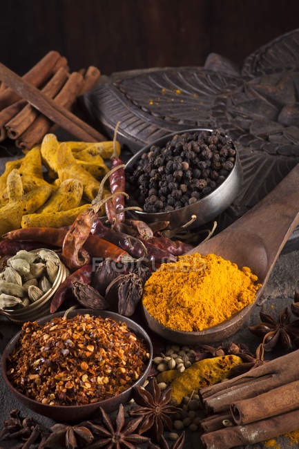 Indian spices in wooden spoon and bowls — Stock Photo