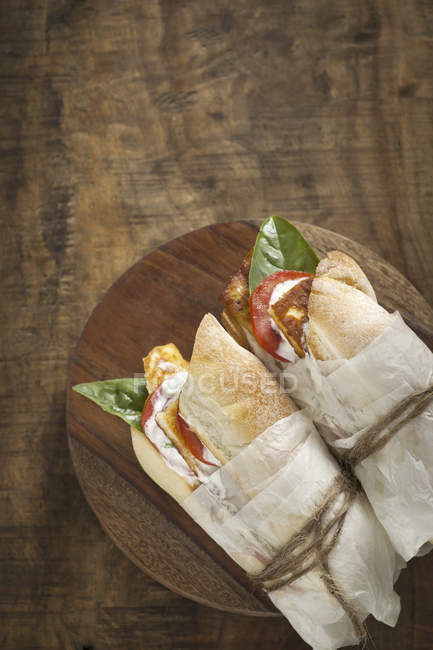 Baguette sandwiches with cheese and tomatoes — Stock Photo
