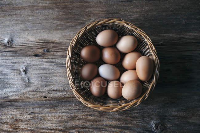 Organic eggs in basket — Stock Photo