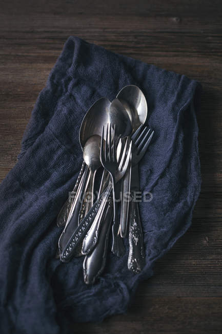 Vintage cutlery on rustic wooden table — Stock Photo