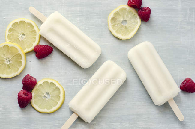 Ice creams with raspberries and lemons — Stock Photo