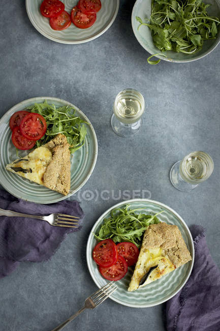 Potato and Sage Galettes with tomatoes — Stock Photo