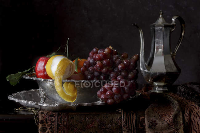 Fruits on metal stand — Stock Photo