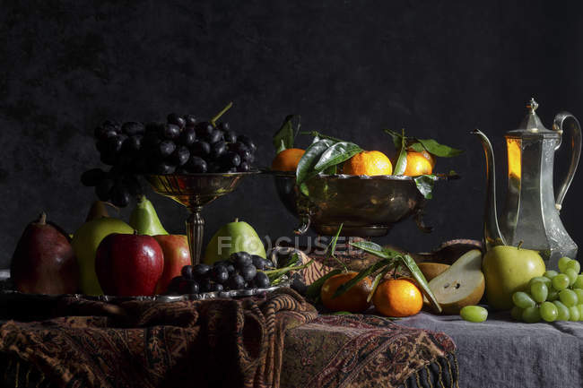 Fruits on metal stands — Stock Photo